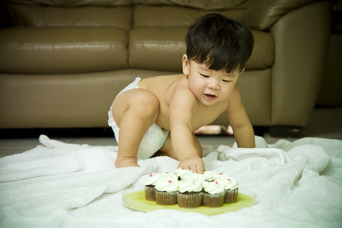 Baby Gets Dirty with Cupcakes