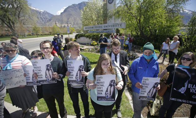 Protesters stand in solidarity with rape victims on the campus of Brigham Young University during a sexual assault awareness demonstration Wednesday, 20 April 2016, in Provo, Utah