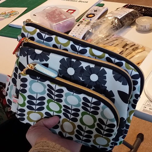 My first sewing goal of 2014--to try to replicate these Orla Kiely pouches I bought at Target, with their interesting half curved zippers. Time to get started.