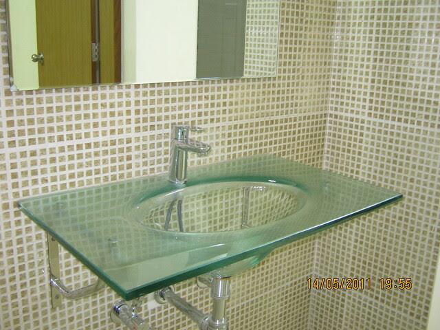 Glass washbasin with a mirror (in the common passage) in a 2 BHK Sample Flat in Om Developers' Tropica, Blessed Township at Ravet PCMC, Pune 412 101