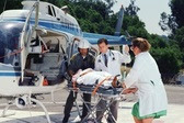 Image of emergency preparedness worker loading patient onto plane