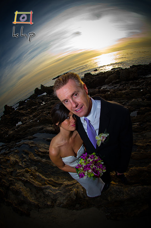 Fish-eye wedding portrait on the beach