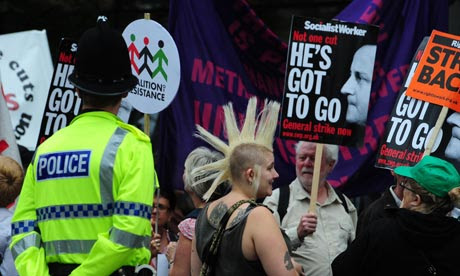Demonstrators take part in a march through Manchester