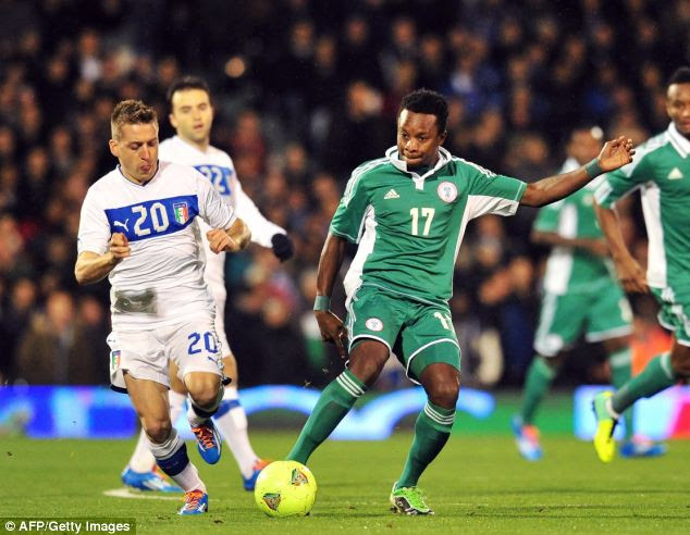None of the World Cup-bound Nigeria players (pictured playing Italy at Craven Cottage last year) are thought to be involved in the potential scam