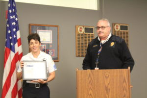 Sgt Cindy Guerra and Fire Chief Michael Schofield. Schofield presented Guerra with the William Bonnar Life Saving Award July 26, 2016