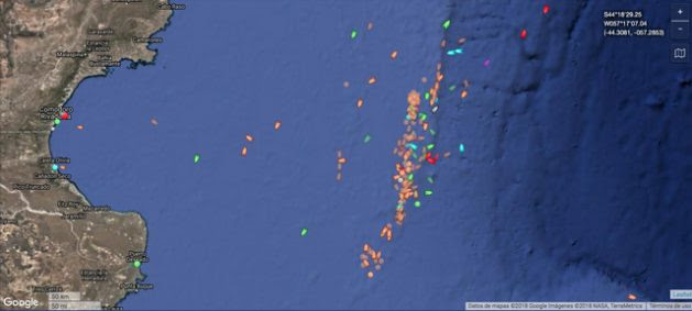 A satellite image shows the great concentration of ships along the boundary of the Argentine Exclusive Economic Zone (EEZ), taking advantage of the lack of regulations to poach huge quantities of seafood. Credit: Courtesy of Milko Schvartzman