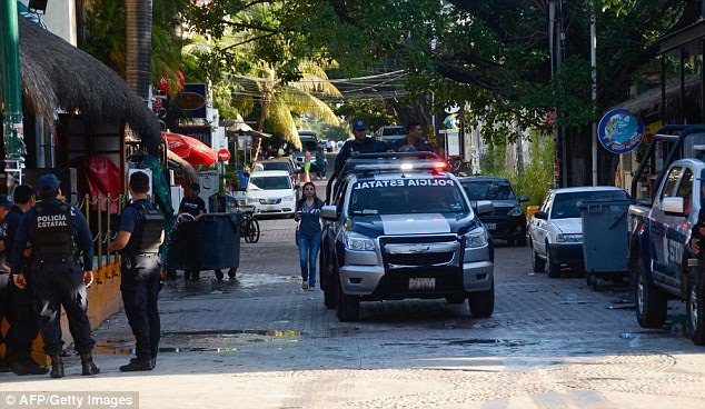As daylight broke in Playa del Carmen on Monday, police investigators were still at the scene
