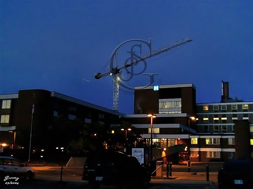 Orillia - Hospital at Night - a view of the hospital at the beginning of construction with the crane in the background