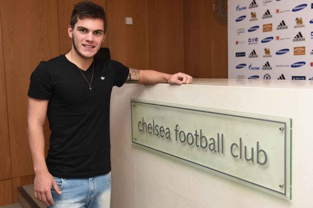 Nathan signs a pre contract for Chelsea at the Cobham Training Ground