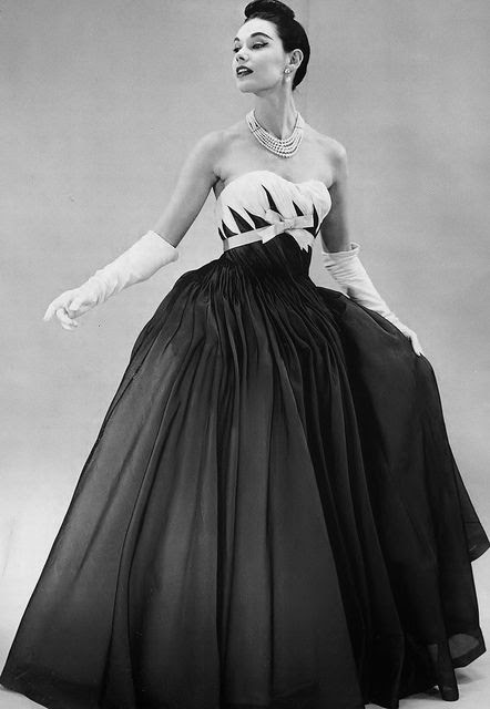 Wonderful bodice details and pleating on this curve hugging 1950s evening dress. #vintage #1950s #fashion #gown #dress