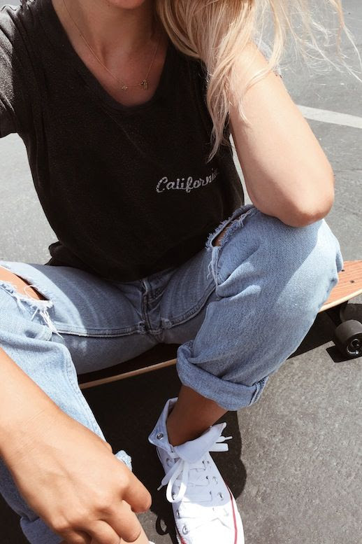 Le Fashion Blog Casual Blogger Style Dainty Gold Necklace Black Embroidered Tee Distressed Boyfriend Denim White High Top Converse Sneakers Via Mija
