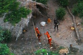 Lost tribe members fire arrows at plane overhead