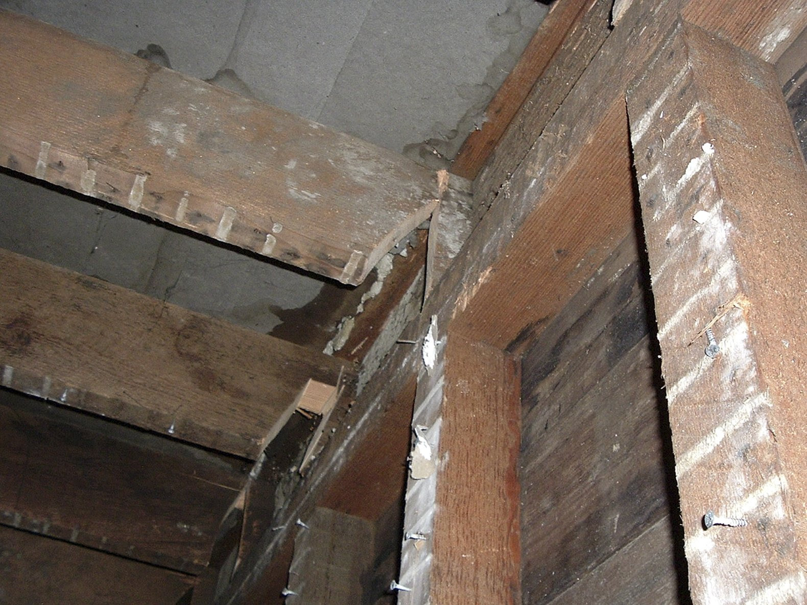 """This undated photo released by the San Francisco Office of the District Attorney shows cut joists under the floor of a San Francisco apartment. A couple prosecutors dubbed the """"landlords from hell"""" for going to scary lengths to drive tenants from a San Francisco apartment building has pleaded guilty to several felonies. Prosecutors said Wednesday that 37-year-old Nicole Macy and 38-year-old Kip Macy threatened to shoot tenants, changed locks, cleared apartments of belongings, and sawed holes in floors, all in an attempt to drive renters out of their building in the increasingly pricey South of Market neighborhood. (AP Photo/San Francisco Office of the District Attorney)"""