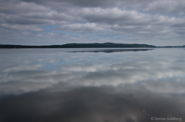 Patterns in clouds and reflections, along the Eastport Peninsula just outside of Terra Nova National Park, Newfoundland