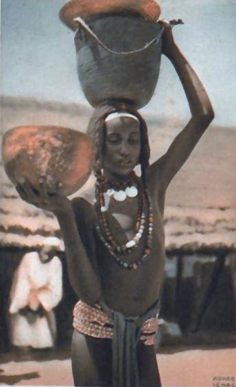 Africa | Girl carrying water.  Baguirmienne (Baguirmi), Chad. ca. 1950 | Scanned postcard image