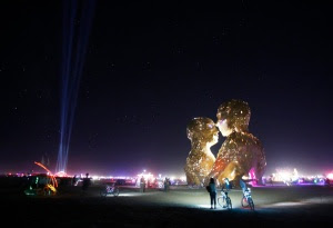 "People look at the art installation Embrace during the Burning Man 2014 ""Caravansary"" arts and music festival in the Black Rock Desert of Nevada"