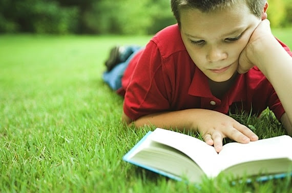 A Young Boy Reading Outside - Photo courtesy of  ©iStockphoto.com/NickS, Image #2013115