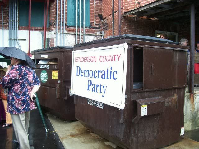 My all-time favorite placement of a Democrat sign, right where it belongs. On a dumpster.  Photo by Bobby Coggins