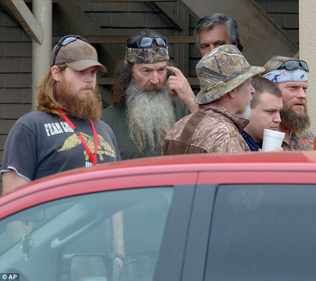 United: Phil Robertson (center), patriarch of the Duck Dynasty family, leaves church in Louisiana with his family today