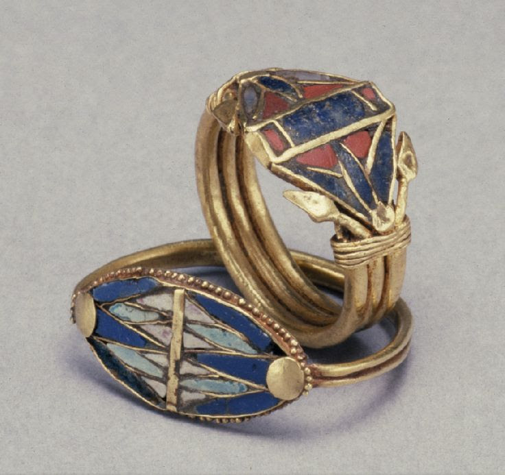 Two Rings with Lotus Flowers; Egypt, gold with glass, lapis lazuli, and carnelian inlay, circa 1400-1200 BC