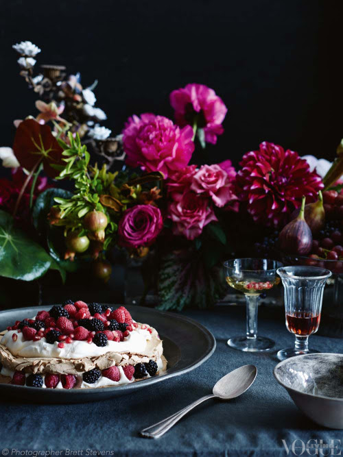 A spray of begonia, roses, dahlias and fresh figs creates the perfect still-life backdrop for this delecate, layered chocolate vino cotto pavlova. From 'At My Table', a story on page 53 of Vogue Living April 2013. Photograph by Brett Stevens.