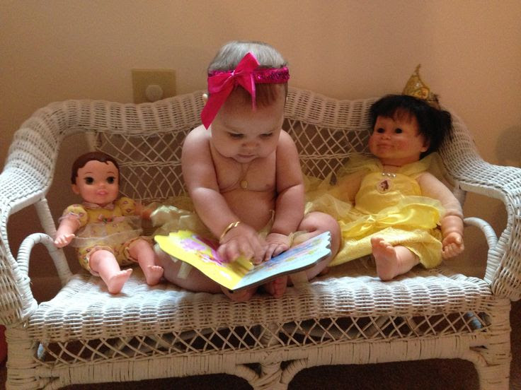 My sweet baby reading to her babies lol