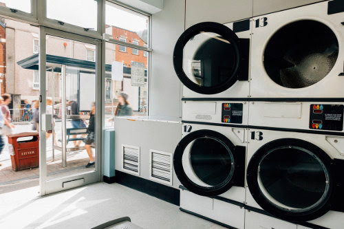 Industrial washing machines at a laundromat