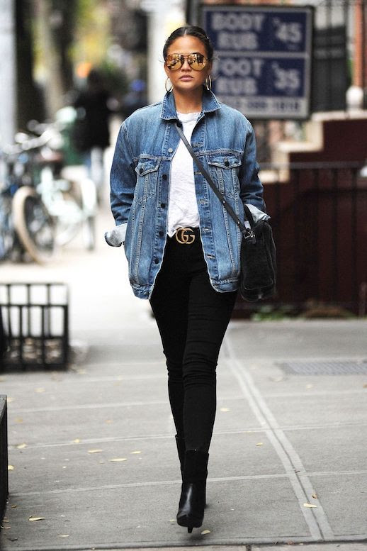 Le Fashion Blog Chrissy Teigen Aviator Sunglasses Denim Jacket White T Shirt Black Skinny Jeans Black Heeled Boots Via Harpers Bazaar