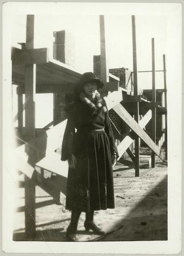 Girl, fur, construction site