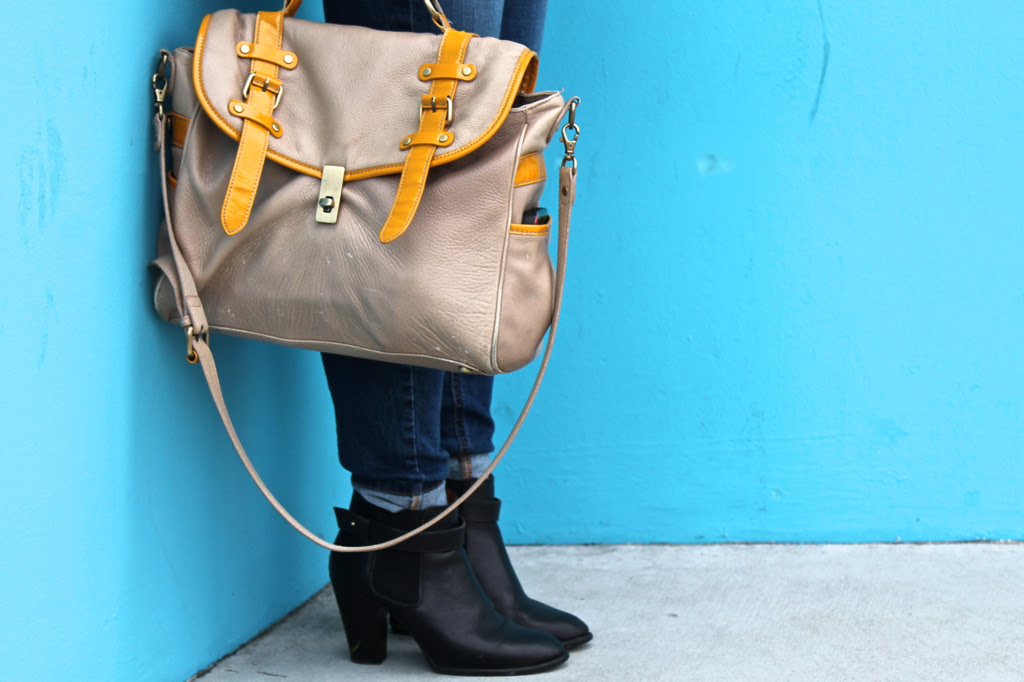 black ankle boots and cuffed skinny jeans