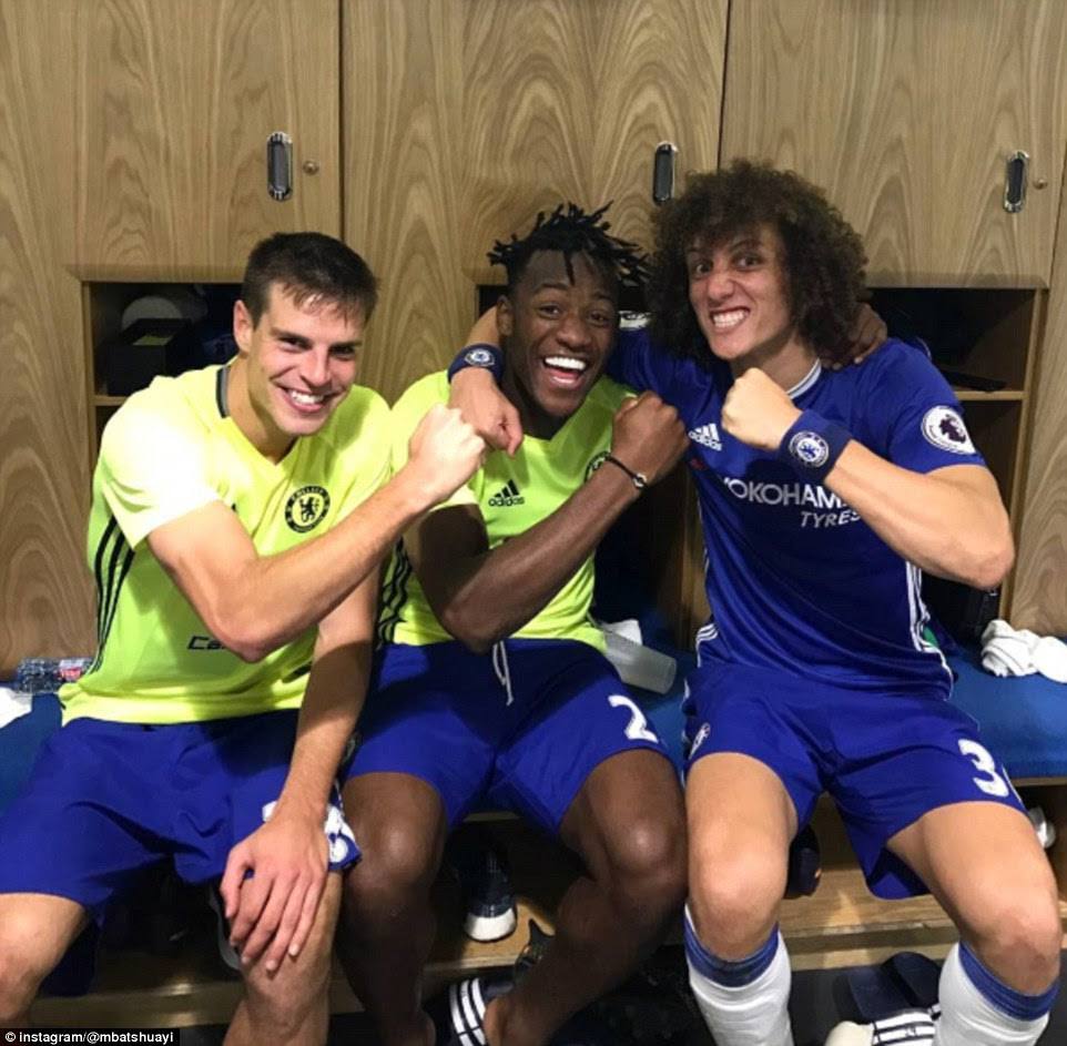 Michy Batshuayi (centre) posted this photo of the celebrations with Cesar Azpilicueta (left) and David Luiz