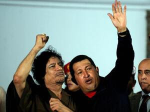 Libyan leader Moammar Gadhafi and Venezuelan President Hugo Chavez, greeting sympathizers in northwestern Venezuela in 2009. Recently, Chavez offered to mediate the dispute between anti-Gadhafi rebels and the Libyan leader, a proposal that was flatly refused by the rebels.