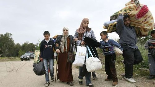 Syrian family crossing into Lebanon fleeing the fighting inside the country. It is estimated that 200,000 have fled Syria. by Pan-African News Wire File Photos