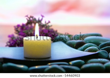 Meditation Candle Burning On A Wood Dish Over A Bed Of Stones With ...