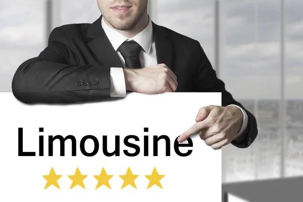 Empresario en estrellas de limusina cinco signo — Foto de Stock #56828989