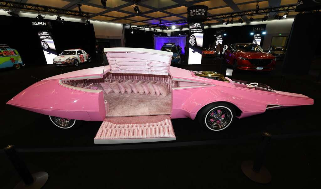 "The fully restorted and functioning ""Pink Panther Car"" is displayed in the ""Galpin Hall of Customs"" at the Los Angeles Auto Show, November 17, 2016 in Los Angeles, California. The Pink Panther Car was built by famed American designer George Barris who built many famous Hollywood custom cars, including the Munster Koach and 1966 Batmobile. The LA Auto Shows consumer days will be open to the public, November 18-27. / AFP / Robyn Beck        (Photo credit should read ROBYN BECK/AFP/Getty Images) Photo: ROBYN BECK/AFP/Getty Images"