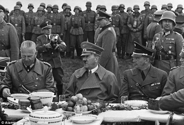 Feast: Hitler and his officers sit at a table laden with fresh fruit and vegetables before the war