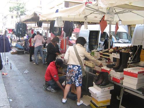 Mui and Maha buying shoes at a market