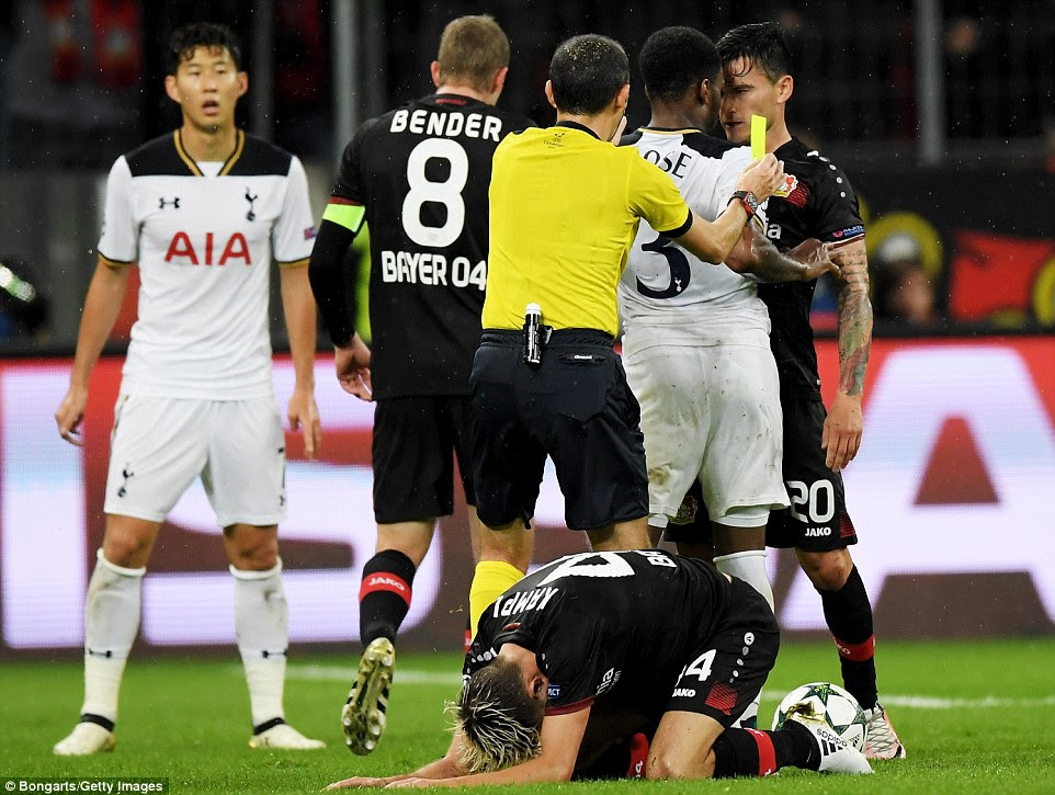 Rose and Aranguiz square up and have to be parted by referee Cuneyt Cakir as Leverkusen's Kampl lies on the ground