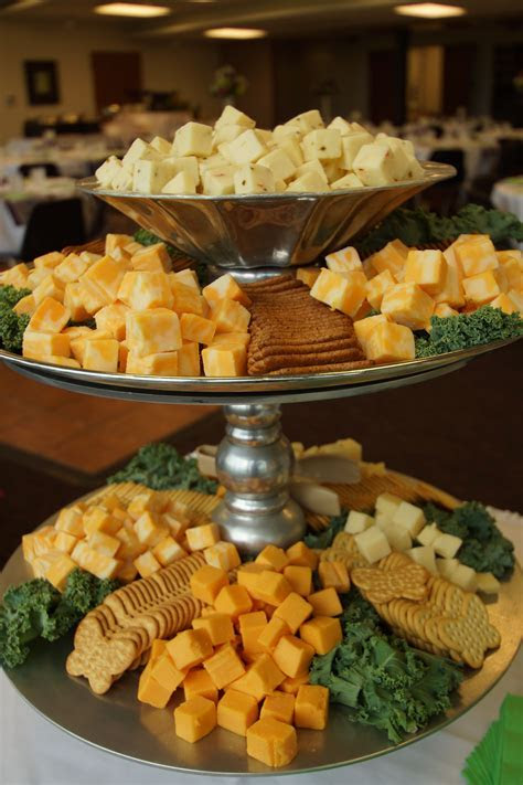 Tiered stand to display assorted cheese cubes and crackers