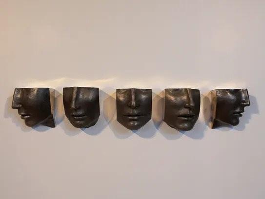 """Set of Five Faces,"" a bronze sculpture by Susan Stamm"