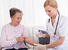 nurse vaccinating elderly lady