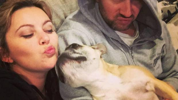 Sharyn and Bryce get wacky with their dog.