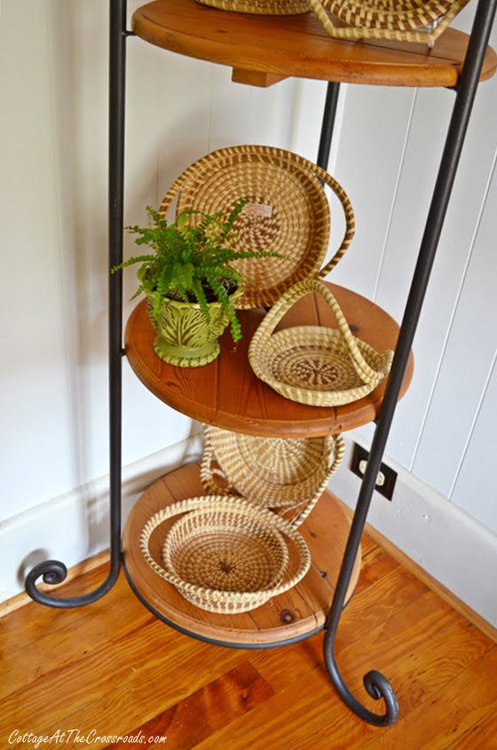 sweetgrass baskets displayed on a iron and pine corner piece | Cottage at the Crossroads