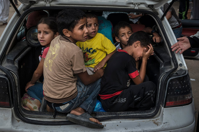 letswakeupworld:  Palestinian children arrive at a shelter in Khan Younis after fleeing fighting.