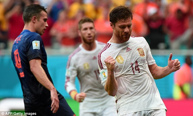Not too Xabi: Alonso celebrates putting Spain a goal up from the spot