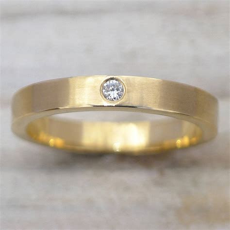 diamond wedding ring in 18ct gold or platinum by lilia