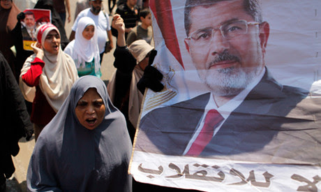 Muslim Brotherhood supporters of ousted President Mohamed Morsi on Aug. 2, 2013 protested in the thousands for his release and restoration to office. by Pan-African News Wire File Photos