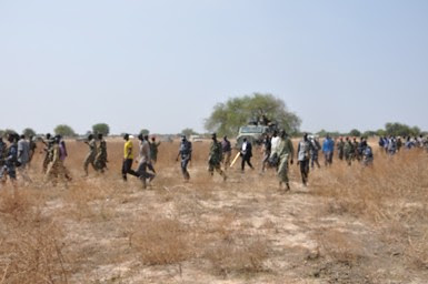 SPLM delegation with Ugandan forces in Bor County, Jonglei state. They were there to investigate an alleged massacre of civilians. by Pan-African News Wire File Photos