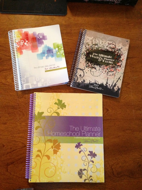 The Ultimate Planner System with the Student and Teen's planner on top and the Parent's Ultimate Planner on the bottom.